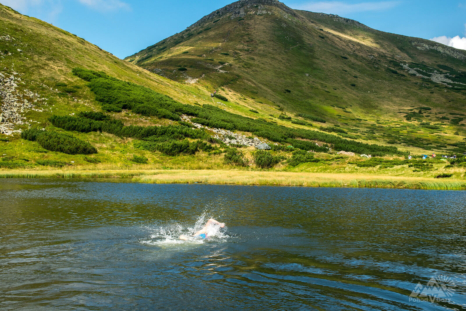 Swimming in the mountain lake Nesamovyte